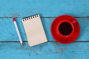 open notebook with blank pages on wooden table